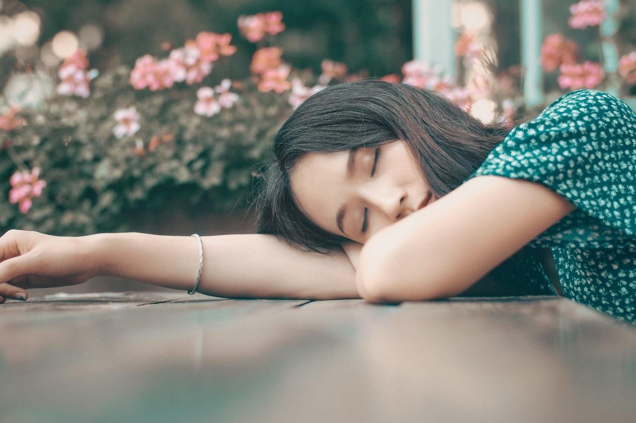 young girl sleeping outdoor