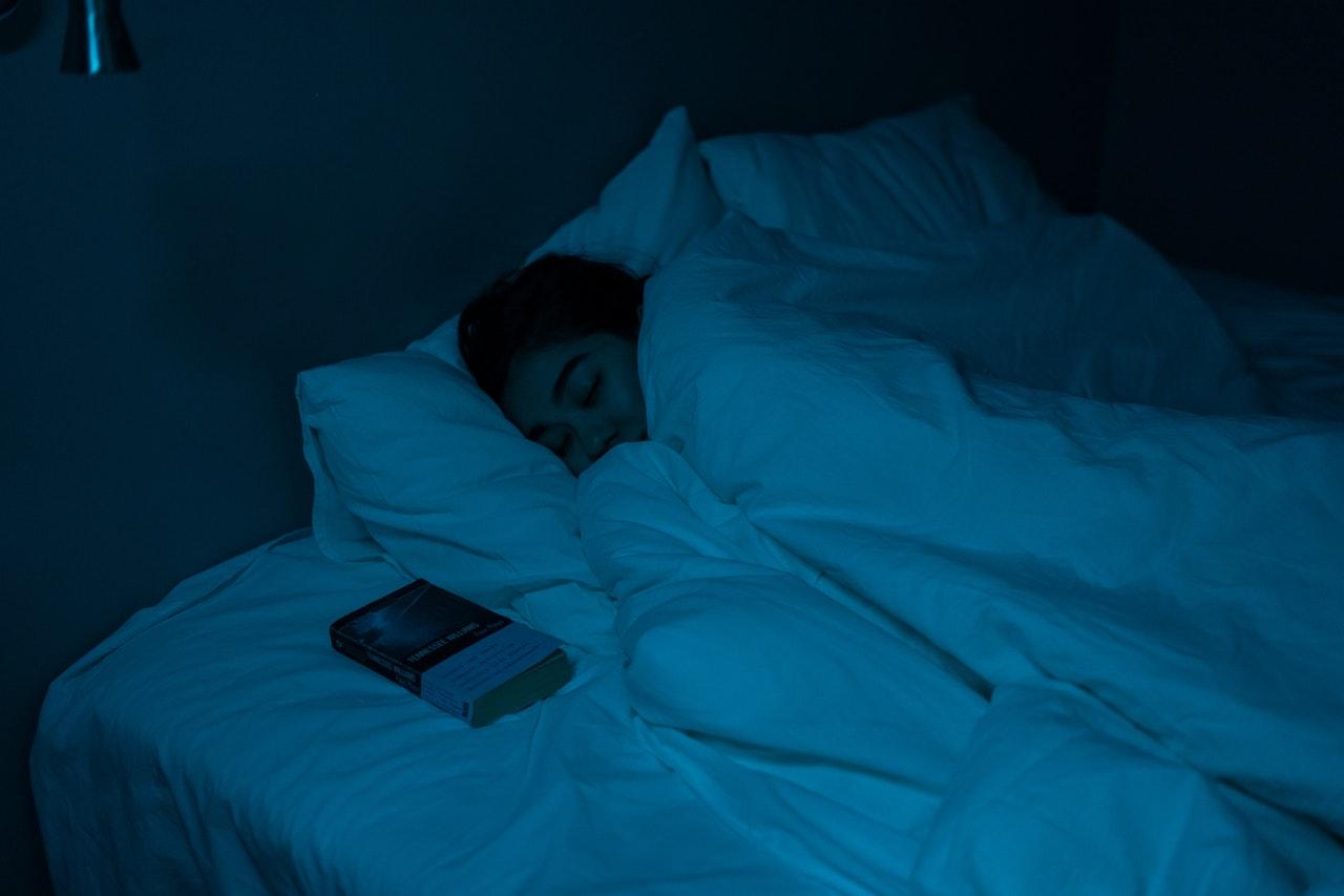 women sleeping in dark bedroom
